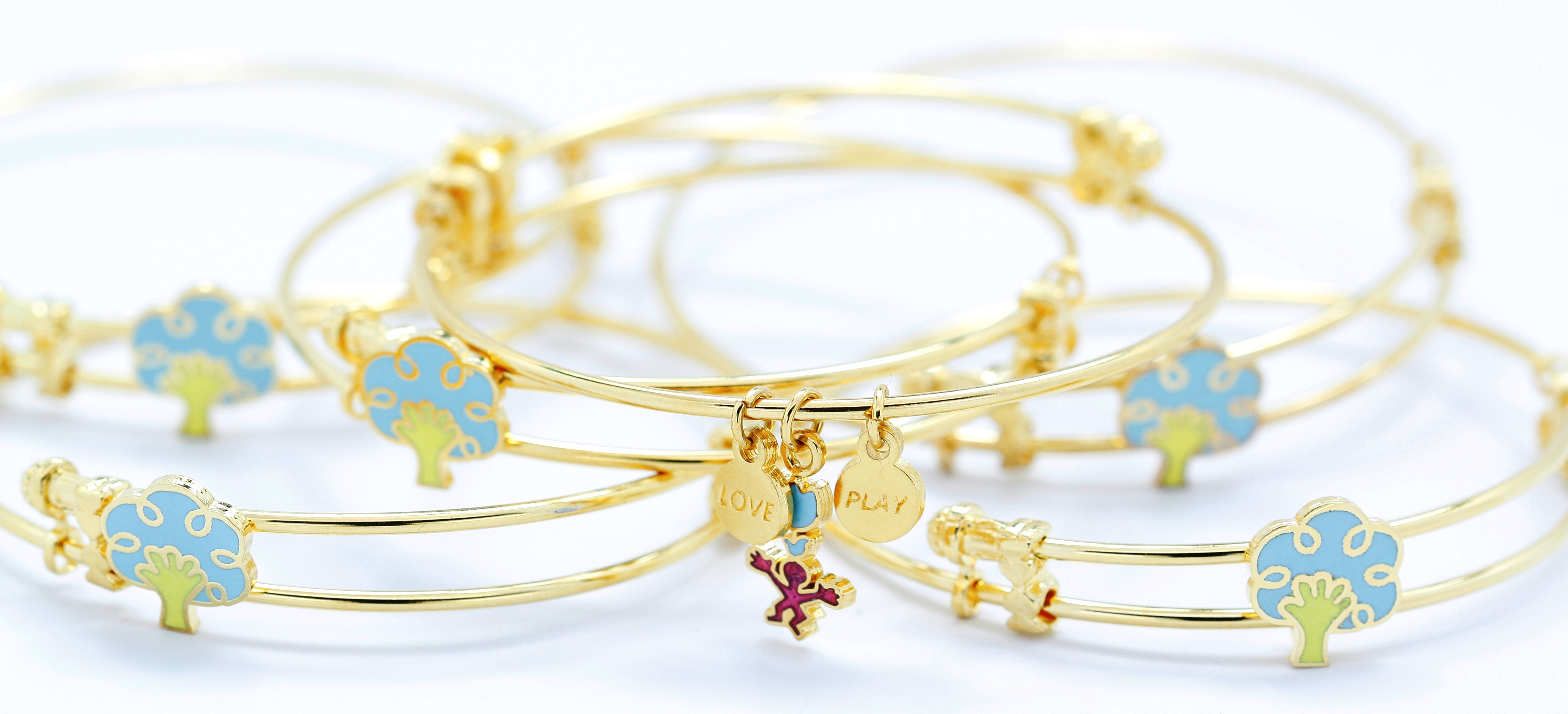 Gold Colored Bangle Bracelet And Charms