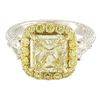 Custom-made Platinum Fancy Yellow Diamond Engagement Ring with Yellow Diamond Halo & White Diamond Shield-Cut Accents